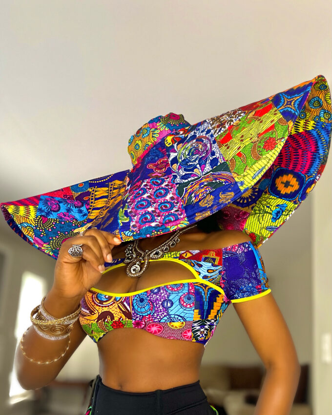 """African Kente Ankara Dashiki """"ATIENO Oversized Hat"""" this season. It's the perfect look for your summer vacation, baecation, weekend getaway, beach or pool party, or for a trip to the Islands."""